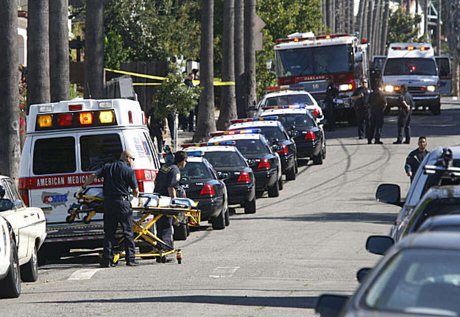 Oakland Police, fire and paramedics fill the corner near East 25th and 9th Avenue, after an Oakland Housing Authority Officer was hit by a car by a suspect on Tuesday Sept. 22, 2009 in Oakland, Calif. Shortly after this incident another OHA officer shot that suspect. Both and suspect and officer are reported to be in stable condition at nearby hospitals. Photo: Mike Kepka, The Chronicle