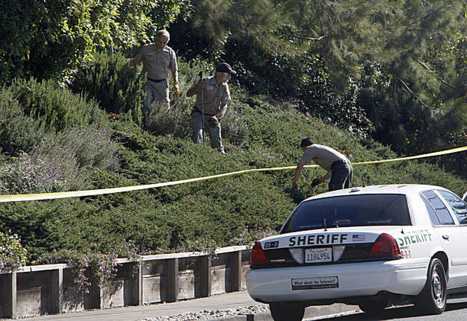 The Marin Sheriff department search the front yard of a private home in the 600 block of Hilary Drive in Tiburon Calif., for any clues that might help them in homicide of a woman in her 70s that was found shot to death today outside her home on September 22, 2009. Photo: Frederic Larson, The Chronicle