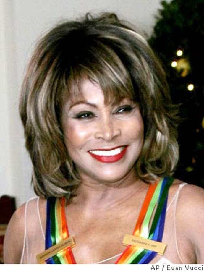 "** FILE ** In this Dec. 4, 2005 file photo, singer Tina Turner arrives at the White House prior to being honored at the Kennedy Center Honors Gala in Washington. Turner says she's hitting the road again for her first tour in the United States in seven years. The 68-year-old songstress announced on ""The Oprah Winfrey Show"" that it will begin Oct. 1 in Kansas City. Tickets for Turner's tour go on sale May 12. Turner appeared with singer-actress Cher, 61, on an episode taped Saturday in Las Vegas before a crowd of 4,000 people. The broadcast is scheduled to air May 8. (AP Photo/Evan Vucci, file) Photo: EVAN VUCCI"