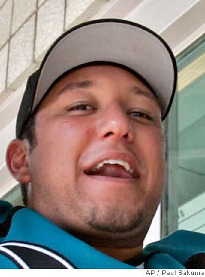 ###Live Caption:**FILE**In this April 24, 2007 file photo, San Jose Sharks fan Adrian Ruiz gestures as he holds up two tickets for Game 3 of the Western Conference semifinals that he just purchased at the Sharks ticket office in San Jose, Calif. Ruiz, 24, a surfer, was killed by a shark attack off the coast of Mexico. Ruiz was surfing at Trancones beach off the Pacific coast of Mexico on Monday, April 28, 2008 when he was bitten by a gray shark on his right thigh. (AP Photo/Paul Sakuma)###Caption History:**FILE**In this April 24, 2007 file photo, San Jose Sharks fan Adrian Ruiz gestures as he holds up two tickets for Game 3 of the Western Conference semifinals that he just purchased at the Sharks ticket office in San Jose, Calif. Ruiz, 24, a surfer, was killed by a shark attack off the coast of Mexico. Ruiz was surfing at Trancones beach off the Pacific coast of Mexico on Monday, April 28, 2008 when he was bitten by a gray shark on his right thigh. (AP Photo/Paul Sakuma)###Notes:Adrian Ruiz###Special Instructions:APRIL 24, 2007 FILE PHOTO Photo: Paul Sakuma