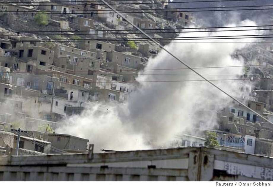 ###Live Caption:Dust and smoke rise from a house in Kabul, April 30, 2008. Five suspected Taliban militants blew themselves up in a house in the Afghan capital Kabul on Wednesday, after being surrounded by Afghan security forces, an Interior Ministry official told Reuters. REUTERS/Omar Sobhani (AFGHANISTAN)###Caption History:Dust and smoke rise from a house in Kabul, April 30, 2008. Five suspected Taliban militants blew themselves up in a house in the Afghan capital Kabul on Wednesday, after being surrounded by Afghan security forces, an Interior Ministry official told Reuters. REUTERS/Omar Sobhani (AFGHANISTAN)###Notes:Dust and smoke rise from a house in the Afghan capital Kabul###Special Instructions:0 Photo: OMAR SOBHANI