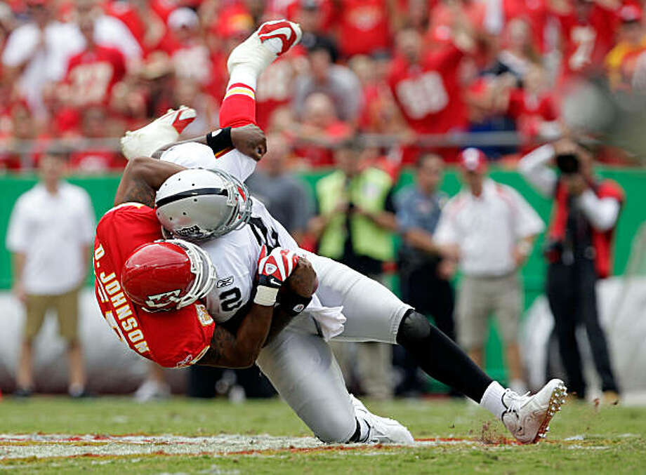 KANSAS CITY, MO - SEPTEMBER 20:  Quarterback JaMarcus Russell #2 of the Oakland Raiders is sacked by linebacker Derrick Johnson #56 of the Kansas City Chiefs during the game at Arrowhead Stadium on September 20, 2009 in Kansas City, Missouri.  (Photo by Jamie Squire/Getty Images) Photo: Jamie Squire, Getty Images