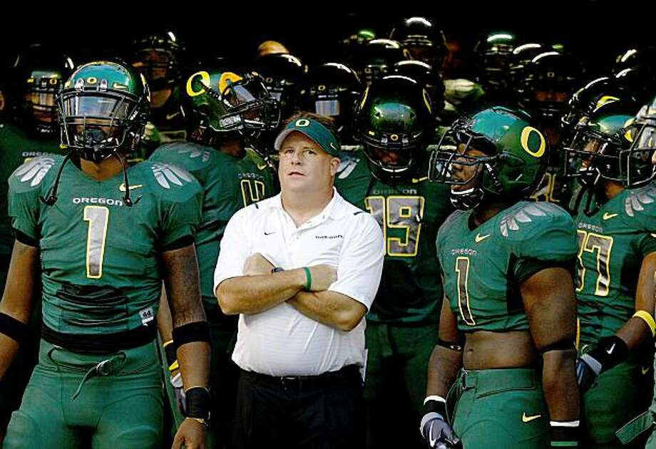 EUGENE, OR - SEPTEMBER 12:  Head Coach Chip Kelly of the Oregon Ducks waits to enter the field before the game against the Purdue Boilermakers  at Autzen Stadium on September 12, 2009 in Eugene, Oregon.  (Photo by Jonathan Ferrey/Getty Images) Photo: Jonathan Ferrey, Getty Images