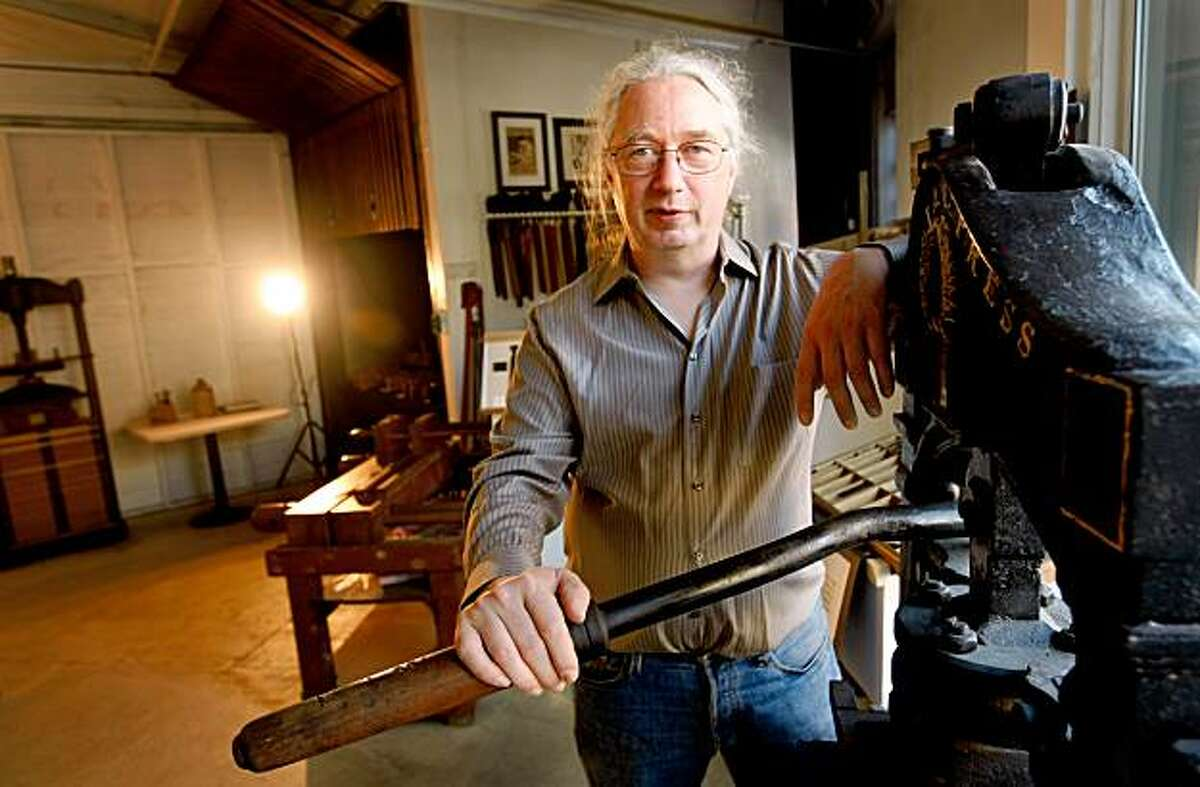 Tim James poses in his American Bookbinders Museum with an 18th century press, Tuesday Sept. 8, 2009, in San Francisco, Calif. James has been collecting bookbinding tools for more than two year and is now opening the Museum to the public on Saturdays.