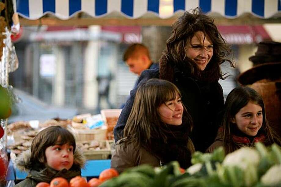 """Elise (Juliette Binoche) and her children in director Cedric Klapisch's 2009 film, """"Paris."""" Photo: IFC Films"""