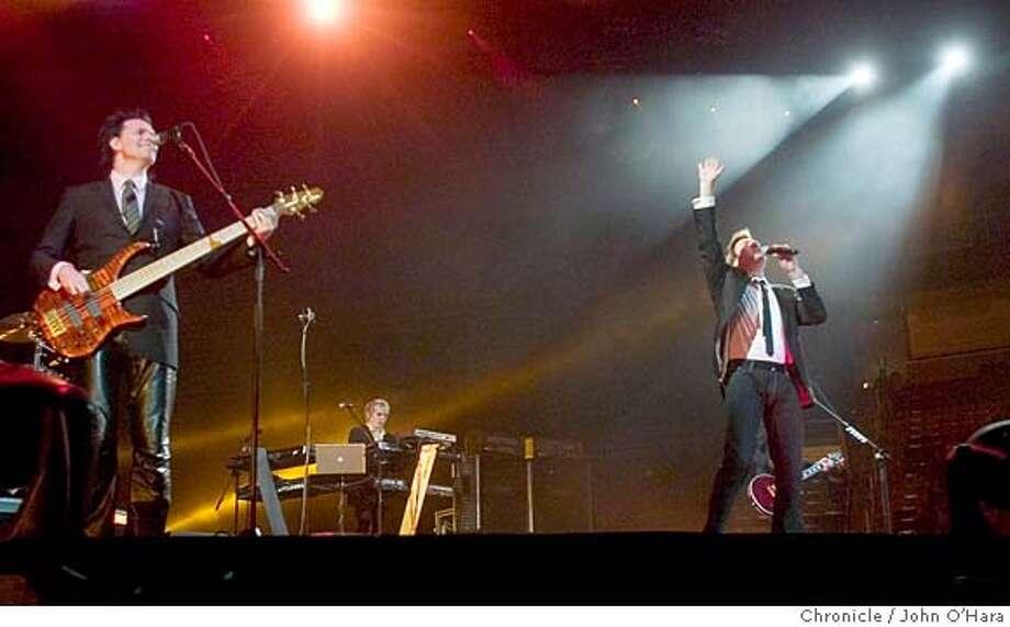 ###Live Caption:DURAN04_008_OHARA.TIF HP Pavillion, 525 W. Santa Clara St.San Jose,CA DURAN DURAN, reunited after 20 years. Simon LeBon/Vocal John Taylor/ base guitar Nick Rhodes/ keyboard photo/John O'Hara###Caption History:DURAN04_008_OHARA.TIF  HP Pavillion, 525 W. Santa Clara St.San Jose,CA  DURAN DURAN, reunited after 20 years.  Simon LeBon/Vocal  John Taylor/ base guitar  Nick Rhodes/ keyboard  photo/John O'Hara###Notes:###Special Instructions: Photo: John O'Hara