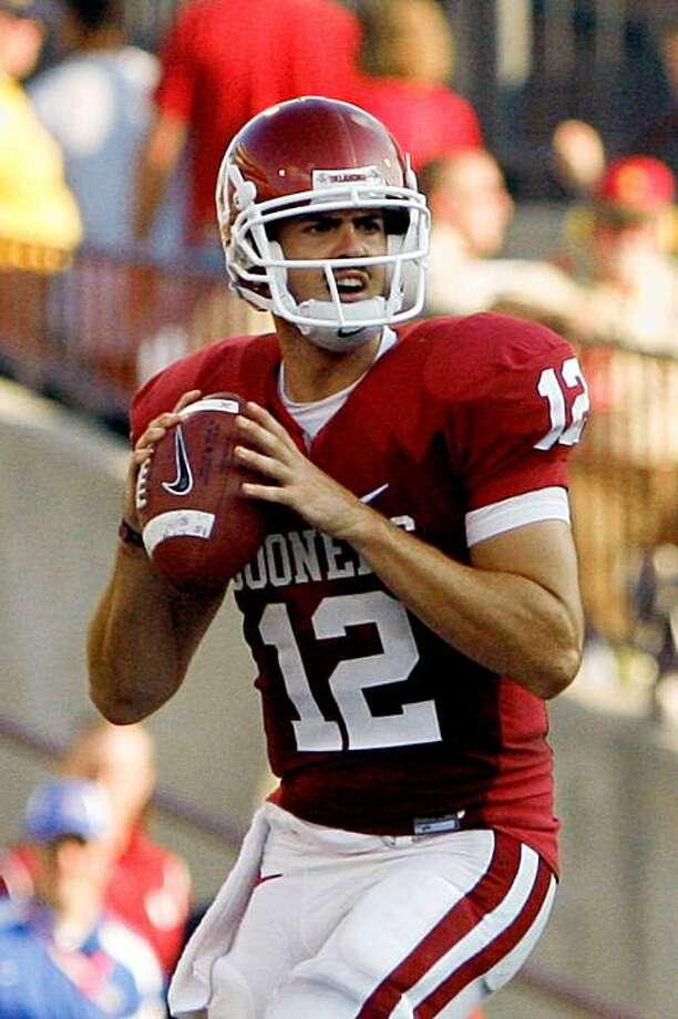Oklahoma quarterback Landry Jones looks for an open receiver in the second half of an NCAA college football game against Tulsa in Norman, Okla. on Saturday, Sept. 19, 2009.  Oklahoma won 45-0.  (AP Photo/Alonzo Adams) Photo: Alonzo Adams, AP