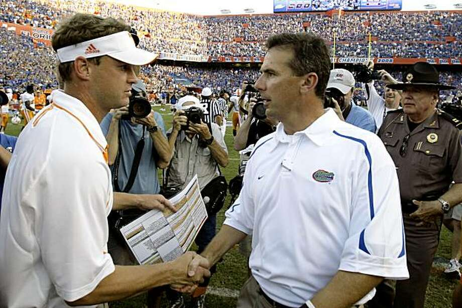 ** CORRECTS SPELLING TO KIFFIN, INSTEAD OF KIFFEN ** Tennessee coach Lane Kiffin, left, and Florida coach Urban Meyer shake hands after an NCAA college football game in Gainesville, Fla., Saturday, Sept. 19, 2009. Florida won 23-13. (AP Photo/John Raoux) Photo: John Raoux, AP