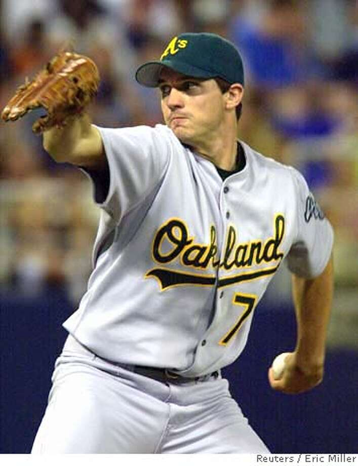###Live Caption:adf###Caption History:Oakland Athletics starting pitcher Barry Zito throws against the Minnesota Twins during the second inning of their American League game in the Metrodome in Minneapolis, September 8, 2002. REUTERS/Eric Miller###Notes:###Special Instructions:CAT 0 Photo: ERIC MILLER