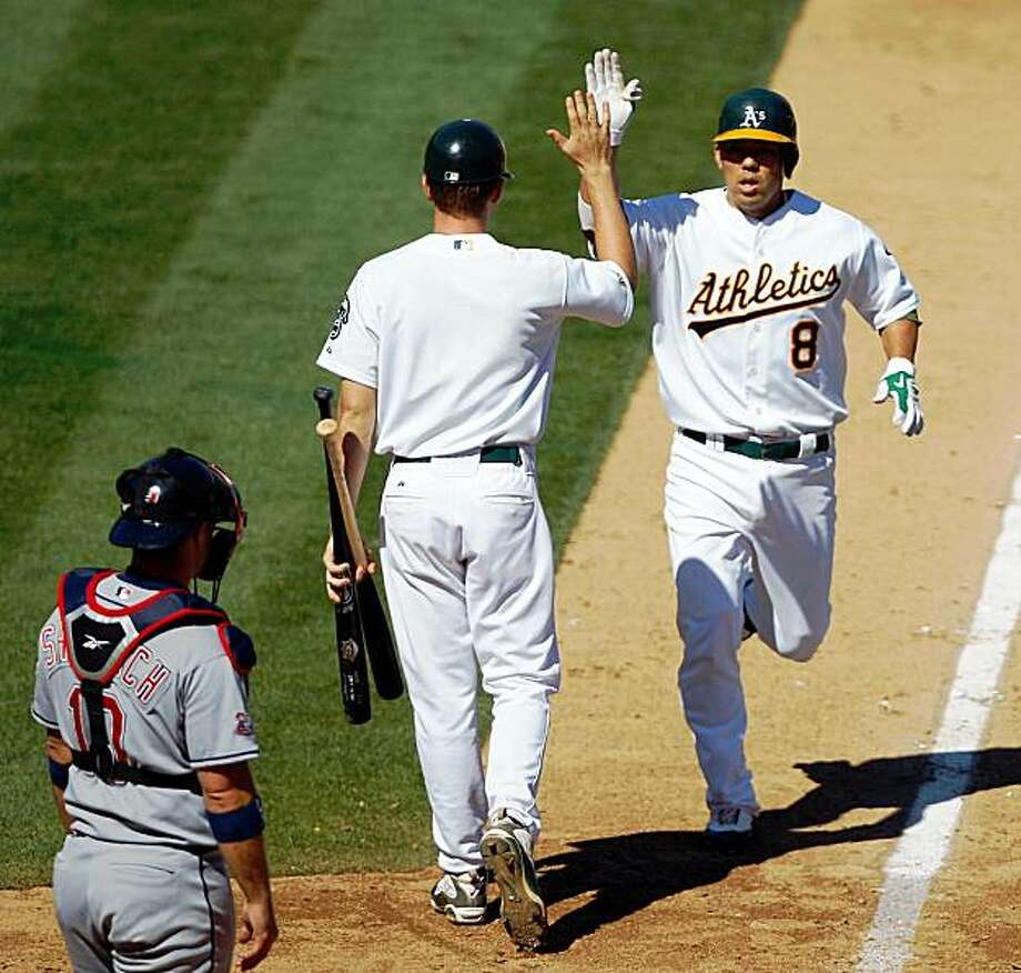 Oakland Athletics' Kurt Suzuki (8) is congratulated by a batboy after hitting a home run against the Cleveland Indians in the fourth inning of a baseball game Saturday, Sept. 19, 2009, in Oakland, Calif. (AP Photo/Ben Margot) Photo: Ben Margot, AP