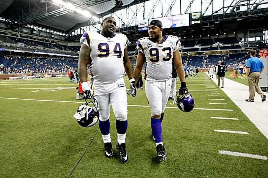 DETROIT - SEPTEMBER 20: Defensive linemen Pat Williams #94 and Kevin Williams #93 of the Minnesota Vikings walk off the field after the game with the Detroit Lions at Ford Field on September 20, 2009 in Detroit, Michigan. The Vikings won 27-13.  (Photo by Stephen Dunn/Getty Images) Photo: Stephen Dunn, Getty Images