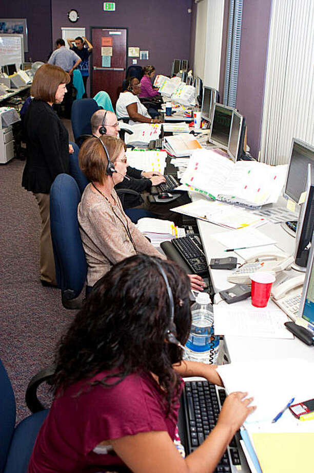 Employment Development Department's employment program representatives process applications and answer questions at EDD's Unemployment Insurance Call Center in Sacramento, Calif., on Thursday, Sept. 17, 2009. The room used to be used as a training room, but has now been converted into an overflow room to handle the volume of calls. Photo: Tony Arias, EDD