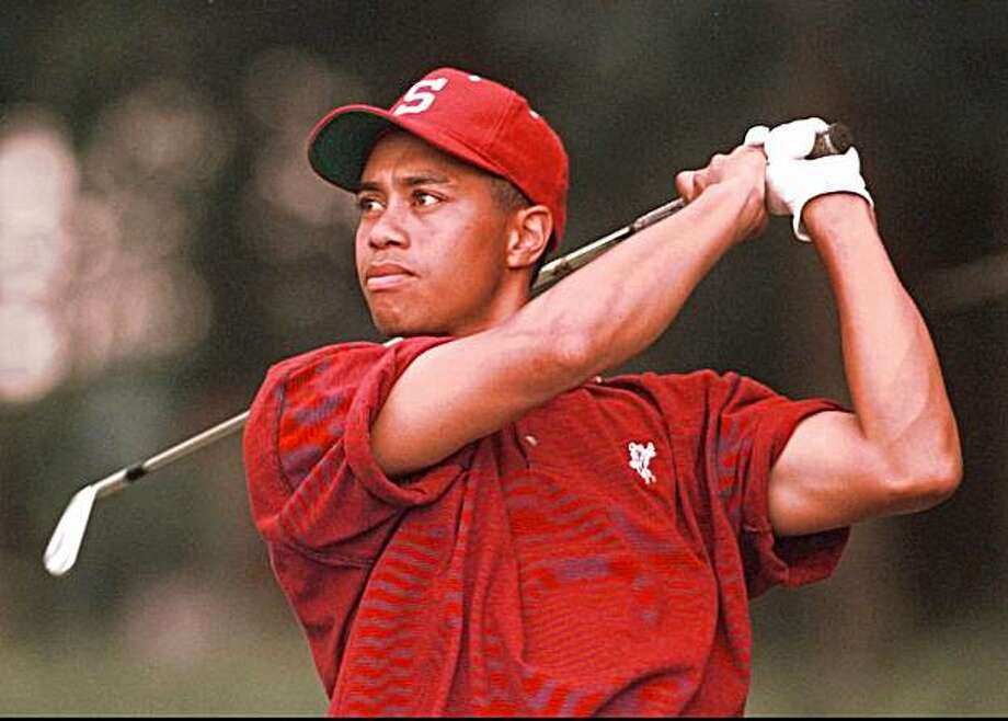 ADVANCE FOR WEEKEND AUG 17 18 FILE--Tiger Woods, of Stanford University, follows his drive on the thirteenth hole during the NCAA Men's Golf Championships in Ooltewah, Tenn., on Wednesday, May 29, 1996. Woods will attempt to win the US Amateur Championship for the third consecutive year starting Monday Aug. 19 near Portland. (AP Photo/Mark Humphrey) Photo: Mark Humphrey, AP