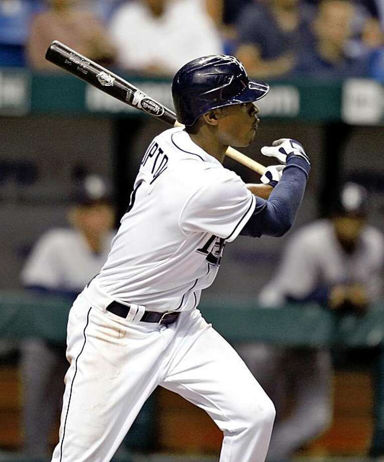 Tampa Bay Rays' B.J. Upton lines a two-run single off Seattle Mariners pitcher Mark Lowe during the eighth inning of a baseball game Wednesday Sept. 23, 2009, in St. Petersburg, Fla. Evan Longoria and Fernando Perez scored on the hit. The Rays won 5-4. (AP Photo/Chris O'Meara) Photo: Chris O'Meara, AP