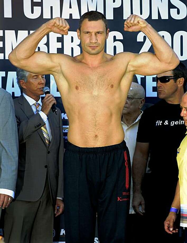 WBC heavyweight champion Vitali Klitschko weighs in for his Saturday boxing match against Cristobal Arreola, Thursday, Sept. 24, 2009, in Los Angeles. (AP Photo/Mark J. Terrill) Photo: Mark J. Terrill, AP