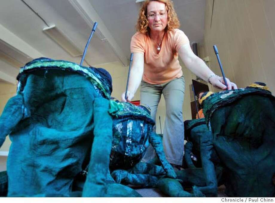 """Valerie Nelson arranges frog puppets for a rehearsal of Ravel's """"L'enfant et les Sortileges"""" in Berkeley, Calif., on Saturday, April 26, 2008.  Photo by Paul Chinn / San Francisco Chronicle  Ran on: 04-30-2008  Valerie Nelson arranges frog puppets for a rehearsal of &quo;L'Enfant et les Sortileges,&quo; an opera that comes alive with theatrics at the Julia Morgan Theater in Berkeley. Photo: Paul Chinn"""