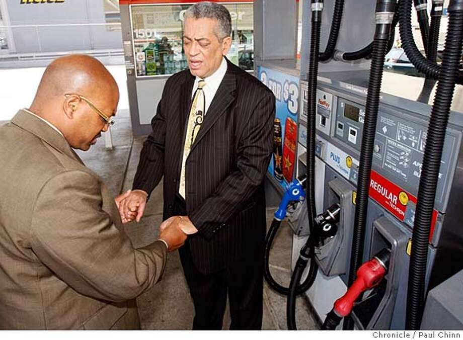 ###Live Caption:Oakland pastor Kendall Guy, left, and Rocky Twyman say prayer for lower gas prices after filling Guy's fuel tank at a Chevron station in San Francisco, Calif., on Friday, April 25, 2008. Guy and Twyman are holding a prayer vigil for cheaper gas prices at Guy's Seventh Day Adventist church on Saturday.  Photo by Paul Chinn / San Francisco Chronicle###Caption History:Oakland pastor Kendall Guy, left, and Rocky Twyman say prayer for lower gas prices after filling Guy's fuel tank at a Chevron station in San Francisco, Calif., on Friday, April 25, 2008. Guy and Twyman are holding a prayer vigil for cheaper gas prices at Guy's Seventh Day Adventist church on Saturday.  Photo by Paul Chinn / San Francisco Chronicle###Notes:Kendall Guy, Rocky Twyman###Special Instructions:MANDATORY CREDIT FOR PHOTOGRAPHER AND S.F. CHRONICLE/NO SALES - MAGS OUT Photo: Paul Chinn