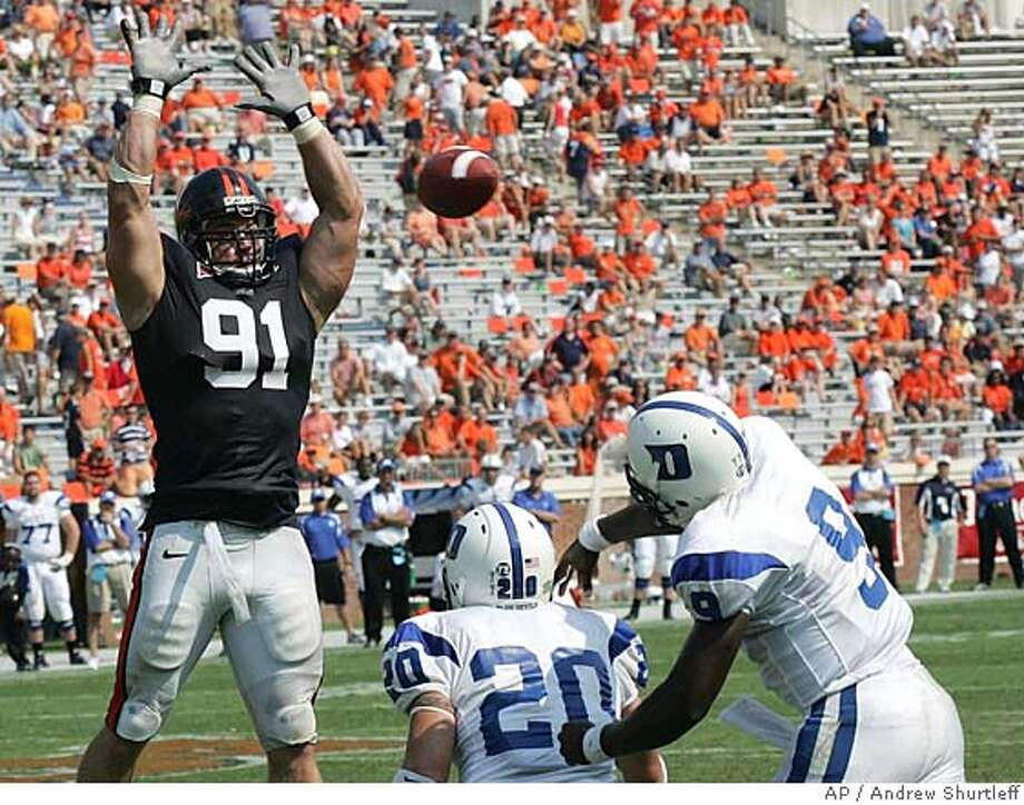 ###Live Caption:** FILE ** Virginia's Chris Long blocks a pass by Duke quarterback Thaddeus Lewis (9) during Virginia's 24-13 win over Duke in a college football game Saturday, Sept. 8, 2005, in Charlottesville, Va., in this Sept. 8, 2005 file photo. Duke's Justin Boyle is at center. No one really wants the first pick in the 2008 NFL draft. Not because there aren't good players, but because there's not one great player, the franchise quarterback who can produce a title with one fling of his arm. (AP Photo/Andrew Shurtleff)###Caption History:** FILE ** Virginia's Chris Long blocks a pass by Duke quarterback Thaddeus Lewis (9) during Virginia's 24-13 win over Duke in a college football game Saturday, Sept. 8, 2005, in Charlottesville, Va., in this Sept. 8, 2005 file photo. Duke's Justin Boyle is at center. No one really wants the first pick in the 2008 NFL draft. Not because there aren't good players, but because there's not one great player, the franchise quarterback who can produce a title with one fling of his arm. (AP Photo/Andrew Shurtleff)###Notes:###Special Instructions:EFE OUT Photo: Andrew Shurtleff