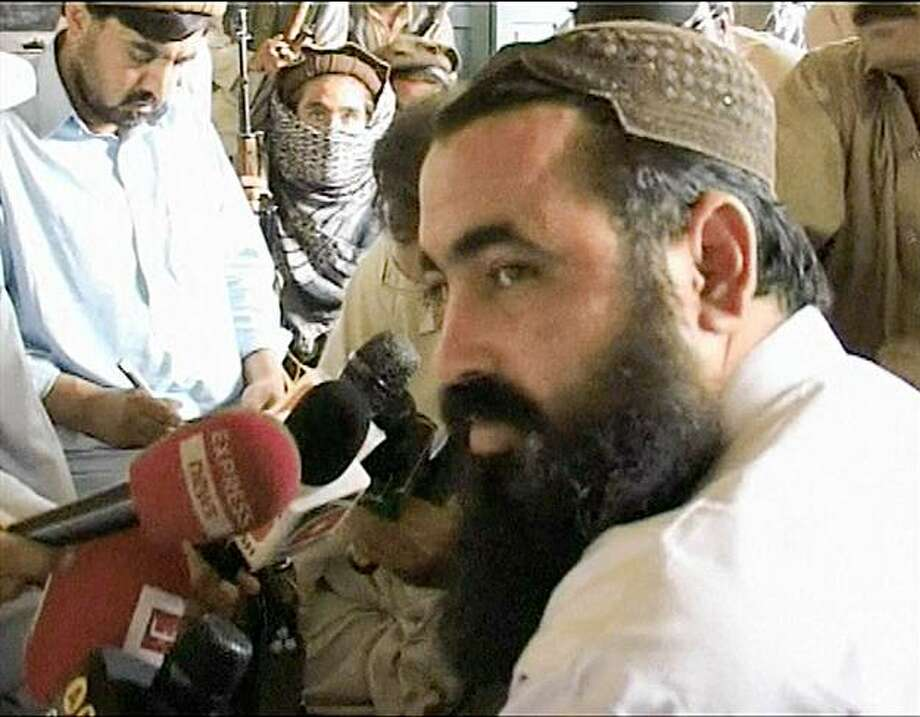 FILE - In this image made from video taken on May 24, 2008, Pakistan's top Taliban leader Baitullah Mehsud, right, talks to the media in Kotkai, a village in the Pakistani tribal area along the Afghan border. Mehsud was killed in a U.S. missile strike on Wednesday Aug. 5, 2009. Recent deaths of militants in Somalia, Indonesia and Pakistan have chipped away at al-Qaida's power base, sapping the terror network of experienced operatives it had been using to train new recruits and wage attacks.  (AP Photo/AP Television Network, file) Photo: AP