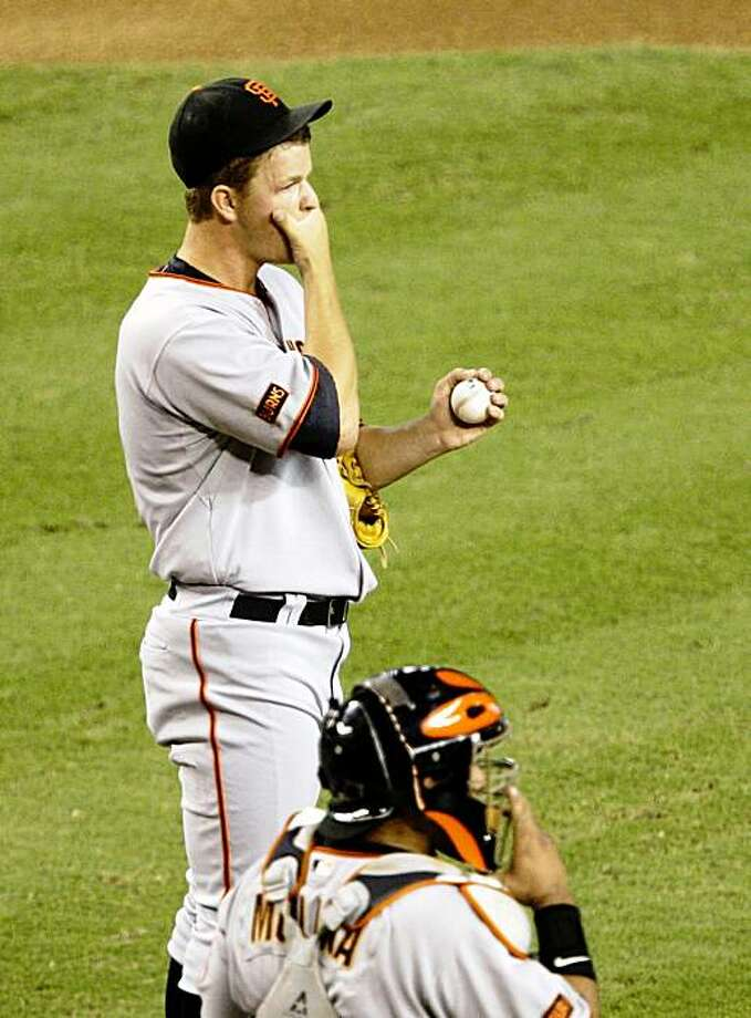San Francisco Giants' Matt Cain, top, pauses with catcher Bengie Molina after Cain gave up a double to Arizona Diamondbacks' Gerardo Parra in the third inning of a baseball game Tuesday, Sept. 22, 2009, in Phoenix. (AP Photo/Ross D. Franklin) Photo: Ross D. Franklin, AP