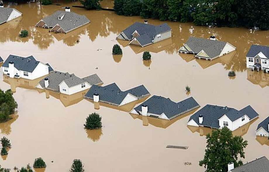 Flooded homes are shown in Mableton, Ga., Tuesday, Sept. 22, 2009. Heavy rains caused flooding in and around the Atlanta area. (AP Photo/John Bazemore) Photo: John Bazemore, AP