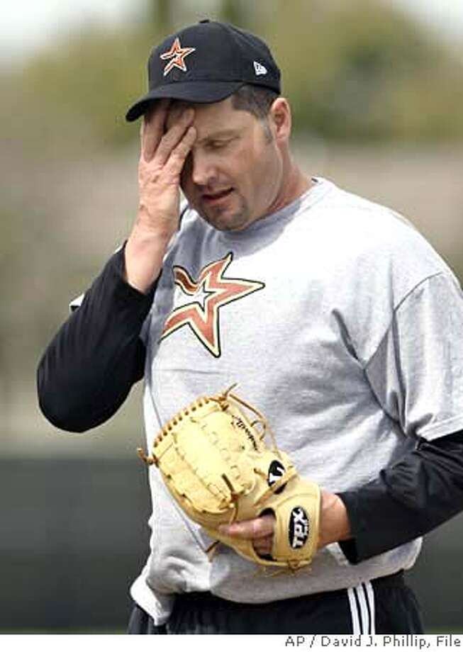"""###Live Caption:Roger Clemens wipes his face while throwing batting practice during a workout at the Houston Astros minor league spring training facility Wednesday, Feb. 27, 2008 in Kissimmee, Fla. Clemens worked with minor leaguers including his son, Koby, who plays catcher. Congress has asked the Justice Department to investigate whether Roger Clemens """"committed perjury and made knowingly false statements"""" to a House committee. (AP Photo/David J. Phillip)###Caption History:Roger Clemens wipes his face while throwing batting practice during a workout at the Houston Astros minor league spring training facility Wednesday, Feb. 27, 2008 in Kissimmee, Fla. Clemens worked with minor leaguers including his son, Koby, who plays catcher. Congress has asked the Justice Department to investigate whether Roger Clemens """"committed perjury and made knowingly false statements"""" to a House committee. (AP Photo/David J. Phillip)  Ran on: 02-29-2008  Roger Clemens was sweating, but not because of the FBI. He was throwing batting practice.###Notes:Roger Clemens###Special Instructions:EFE OUT Photo: David J. Phillip"""