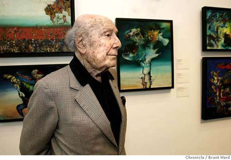 ###Live Caption:Enrico Donati stood near a series of paintings done between 1943 and 1946 which were inspired by African-Oceanic art. Artist Enrico Donati, 98 years, is the last living Surrealist artist closely associated with the movement's acknowledged leader, Andre Breton. A room is devoted to his work at the de Young Museum in San Francisco. {Brant Ward/San Francisco Chronicle}7/16/07###Caption History:donati_205.JPG  Enrico Donati stood near a series of paintings done between 1943 and 1946 which were inspired by African-Oceanic art.  Artist Enrico Donati, 98 years, is the last living Surrealist artist closely associated with the movement's acknowledged leader, Andre Breton. A room is devoted to his work at the de Young Museum in San Francisco.  {Brant Ward/San Francisco Chronicle}7/16/07 Ran on: 08-12-2007  Surrealist painter Enrico Donati, 98, at the M.H. de Young Memorial Museum, where his work is on display.###Notes:###Special Instructions: Photo: Brant Ward