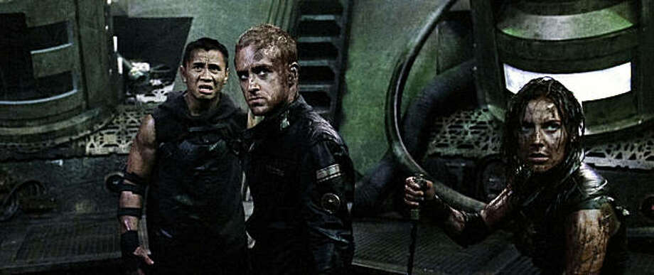 (Left to right.) Cung Le, Antje Traue and Ben Foster star in Overture Films' Pandorum. PUBLICITY OR REVIEWS OF THIS SPECIFIC MOTION PICTURE ARE TO REMAIN THE PROPERTY OF THE STUDIO. NOT FOR SALE OR REDISTRIBUTION. Photo: Courtesy, Constantin Film Production