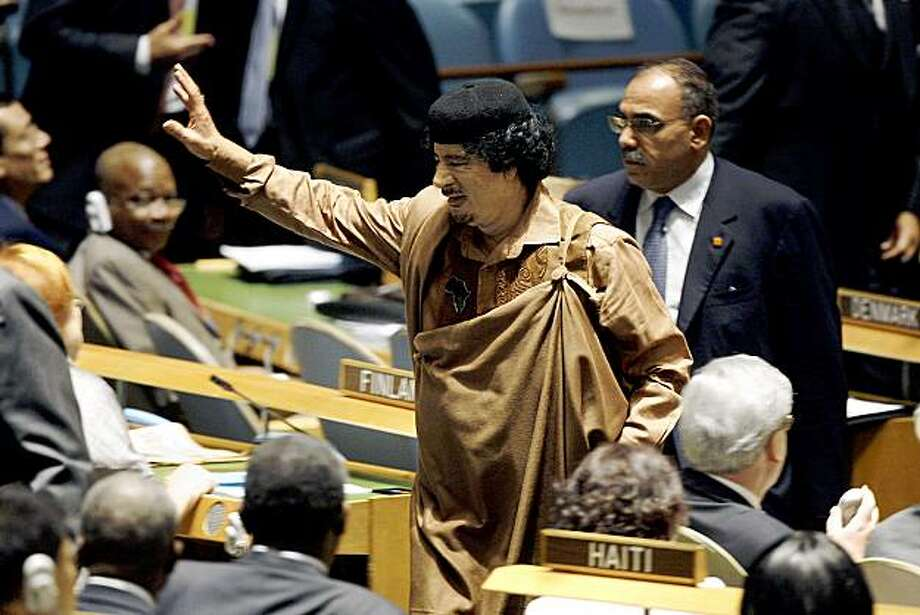 NEW YORK - SEPTEMBER 23:  Libyan leader Col. Moammar Gadhafi exits after addressing the United Nations General Assembly at the U.N. headquarters on September 23, 2009 in New York City.  This is the 64th session of the United Nations General Assembly featuring leaders from over 120 countries.  (Photo by Rick Gershon/Getty Images) Photo: Rick Gershon, Getty Images