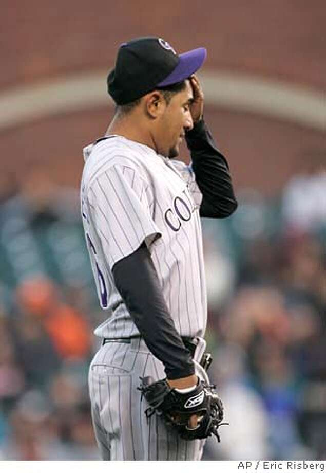 Colorado Rockies starting pitcher Franklin Morales wipes his head after the San Francisco Giants scored their second run in the first inning of their baseball game in San Francisco, Monday, April 28, 2008. (AP Photo/Eric Risberg) Photo: Eric Risberg