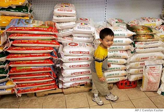 ###Live Caption:Alex Ly, 4, plays near sacks of rice in back of his family's store, Kim's Oriental Foods, in Harrisburg, Thursday, April 24, 2008. This is all the rice the store has available, far less than usual, and there is none in their storage room. U.S. rice futures have hit a record high amid global food inflation. (AP Photo/Carolyn Kaster)###Caption History:Alex Ly, 4, plays near sacks of rice in back of his family's store, Kim's Oriental Foods, in Harrisburg, Thursday, April 24, 2008. This is all the rice the store has available, far less than usual, and there is none in their storage room. U.S. rice futures have hit a record high amid global food inflation. (AP Photo/Carolyn Kaster)###Notes:###Special Instructions: Photo: Carolyn Kaster