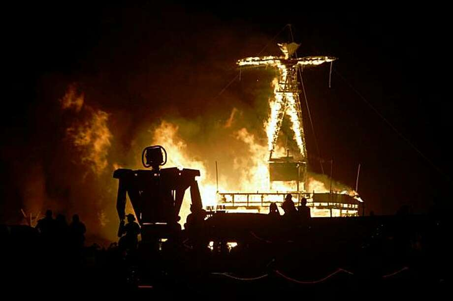 Fireworks and flames marked the burning of the man as thousands watched on the playa Saturday night as the centerpiece of Burning Man 2005, September 3, 2005 in the Black Rock desert. Photo: Chris Stewart, The Chronicle, 2005