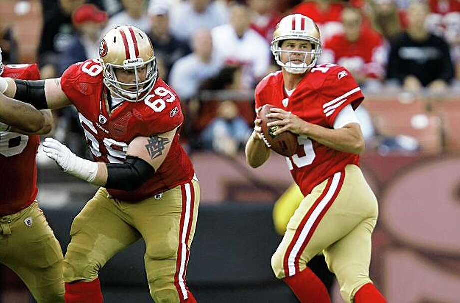 San Francisco 49er quaretrback Shaun Hill (13) behind the blocking by San Francisco 49er Tony Wragge (69) as the San Francisco 49ers take on the Oakland Raiders at Candlestick Park in San Francisco, Calif., on Saturday August 22, 2009, in a pre-season game. Photo: Michael Macor, The Chronicle