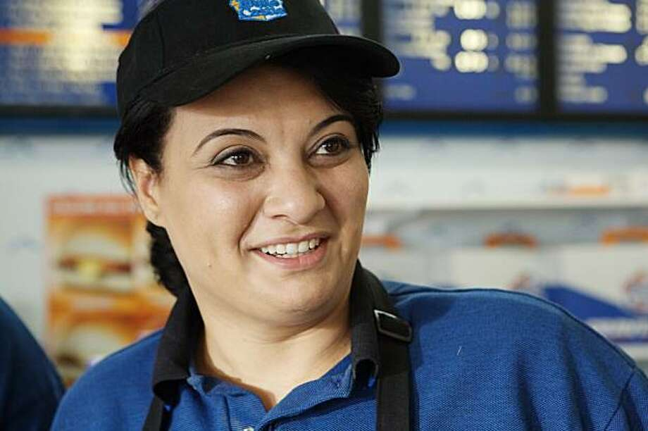 "Muna (Nisreen Faour) works in an Illinois White Castle fast-food restaurant in Cherien Dabis' film, ""Amreeka."" Photo: National Geographic Films"