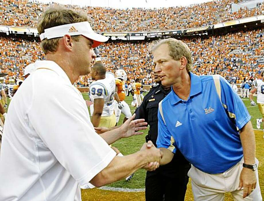 UCLA coach Rick Neuheisel, right, shakes hands with Tennessee coach Lane Kiffin after thier NCAA college football game Saturday, Sept. 12, 2009 in Knoxville, Tenn. UCLA won 19-15. (AP Photo/Wade Payne) Photo: Wade Payne, AP