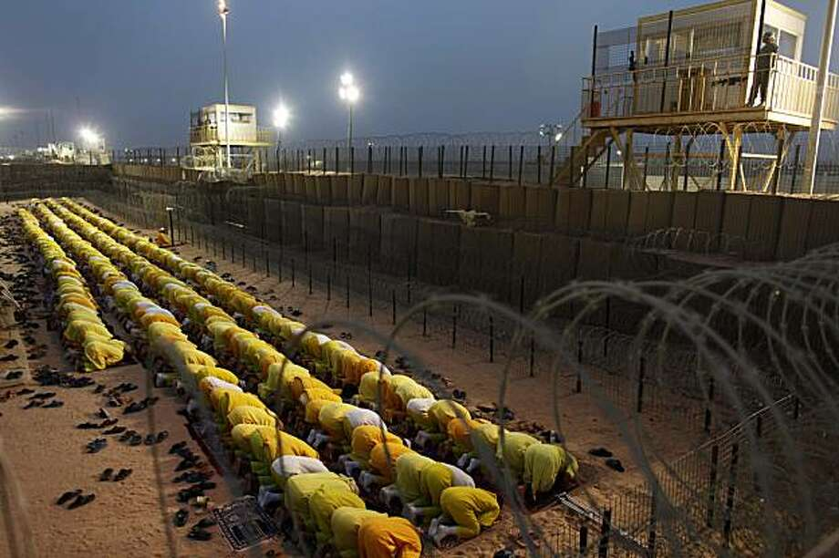 In this Monday, March 16, 2009 file photo, detainees pray at a U.S. military detention facility Camp Bucca, Iraq. The U.S. military closed Camp Bucca Wednesday Sept. 16, 2009 that was its first and, at one time, largest lockup in Iraq, as it forges ahead with plans to release thousands of remaining detainees or transfer them to Iraqi custody before year's end. Photo: Dusan Vranic, AP