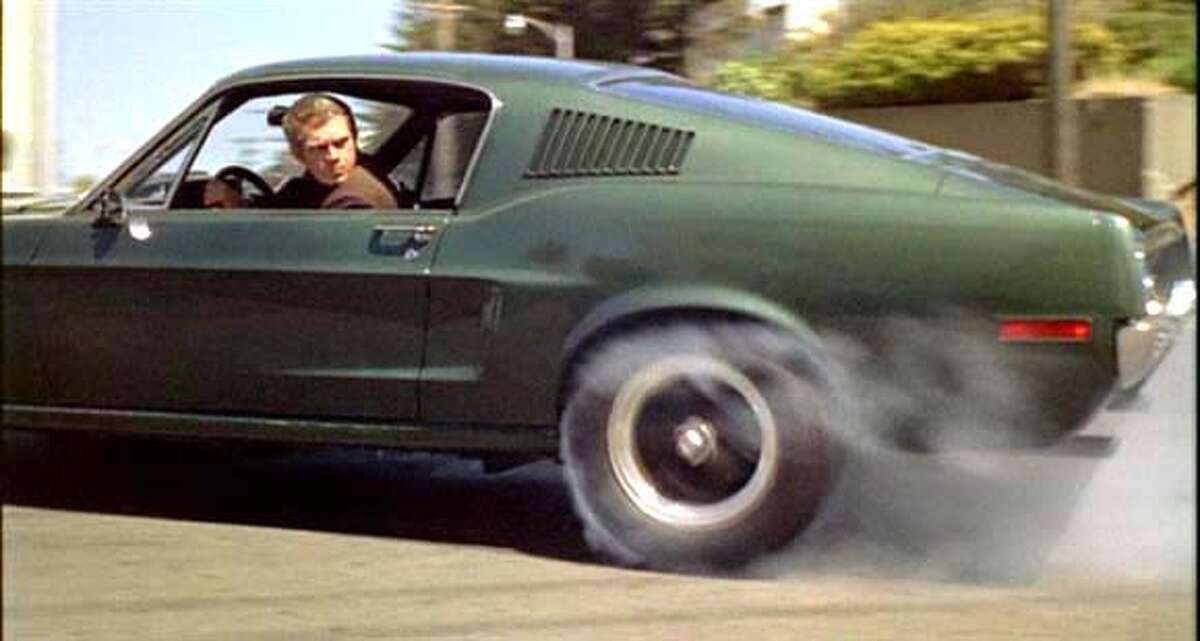 ###Live Caption:Steve McQueen on the set of the movie Bullitt, in which he drove in the finest chase scene.###Caption History:Steve McQueen in