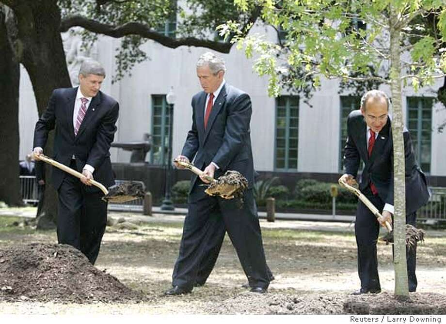 ###Live Caption:U.S. President George W. Bush (C), Mexico's President Felipe Calderon (R), and Canada's Prime Minister Stephen Harper plant a tree in honor of Earth Day while in New Orleans, Louisiana, April 22, 2008. REUTERS/Larry Downing (UNITED STATES)###Caption History:U.S. President George W. Bush (C), Mexico's President Felipe Calderon (R), and Canada's Prime Minister Stephen Harper plant a tree in honor of Earth Day while in New Orleans, Louisiana, April 22, 2008. REUTERS/Larry Downing (UNITED STATES)###Notes:U.S. President George W. Bush, Mexico's President Felipe Calderon, and Canada's Prime Minister Stephen Harper plant a tree in honor of Earth Day while in New Orleans###Special Instructions:0 Photo: LARRY DOWNING