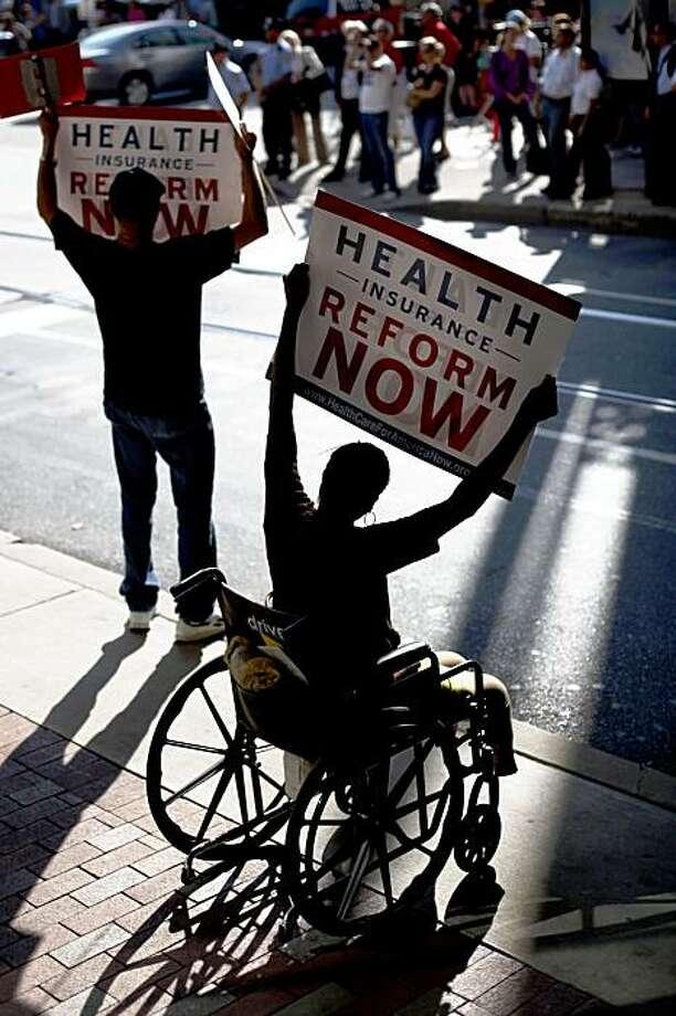 Wayne Waters, left, and Annette Higgins, both of Philadelphia, protest outside a fundraiser for Sen. Arlen Specter, D-Pa. attended by President Barack Obama in Philadelphia, Tuesday, Sept. 15, 2009. (AP Photo/Matt Rourke) Photo: Matt Rourke, AP