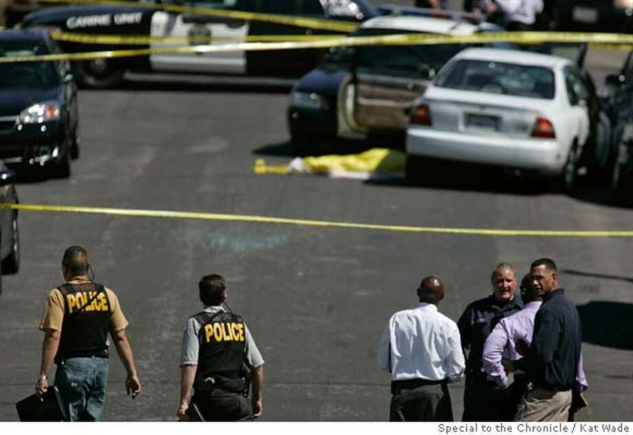 From left, Alameda police officers Don Owyang and Rod Rummel arrive at the scene near Alameda where Oakland police shot and killed a suspect after a chase at 29th Avenue and East 7th Street in Oakland, Calif. on Saturday, April 26, 2008.  Photo by Kat Wade / Special to the Chronicle Photo: Kat Wade
