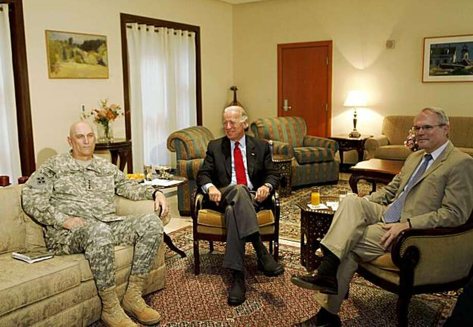 The US Vice President Joe Biden  sits ahead of his meeting with the top US commander in Iraq Gen. Ray Odierno, left, and US Ambassador to Iraq  Christopher Hill  in Baghdad, Iraq, Tuesday, Sept. 15, 2009. Four mortar shells landed in the Green Zone as Vice President Joe Biden arrived in Iraq Tuesday on a previously unannounced mission to help the country resolve its differences ahead of America's military withdrawal.(AP Photo/Hadi Mizban) Photo: Hadi Mizban, AP