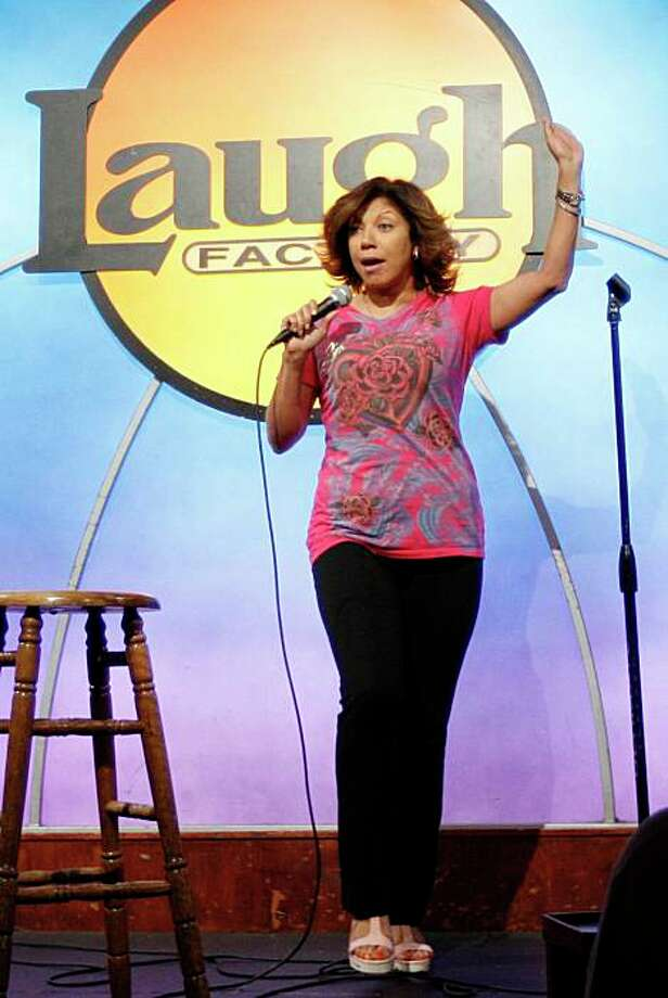 Sunda Croonquist performs during Open Mic Night at the Laugh Factory in Los Angeles on Tuesday, June 16, 2009.  The veteran comic is being sued by her mother-in-law after making her the punchline of too many jokes. (AP Photo/Matt Sayles) Photo: Matt Sayles, AP / ONLINE_YES