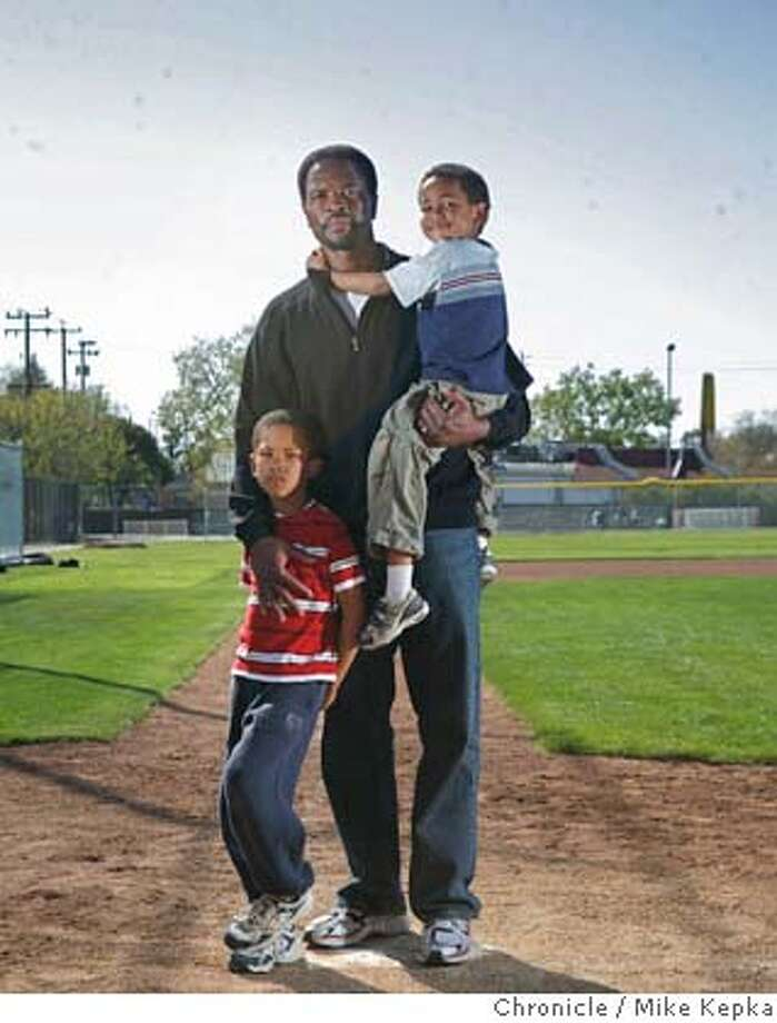 Cincinnati Reds baseball scout, Greg McCalin, with his boys Charles, 6, and Ellis, 4, poses for a portrait at a local baseball field on , 2008 in Oakland, Calif. McClain and his boys are learning to cope with the loss of wife and mother Amy who died of a rare pulmonary disease last summer. Photo by Mike Kepka / San Francisco Chronicle Photo: Mike Kepka