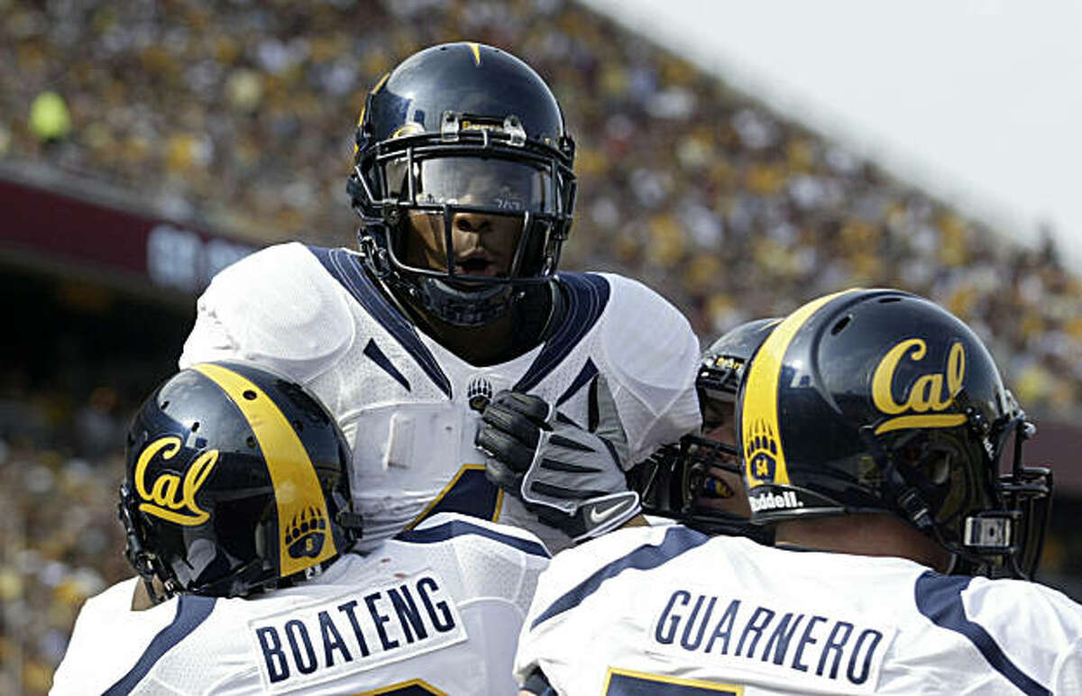 California tailback Jahvid Best (4) celebrates his 33-yard touchdown run against Minnesota with teammates Nyan Boateng (8) and Chris Guarnero (54) during the first half of a NCAA football game, Saturday, Sept. 19, 2009 in Minneapolis. Best rushed for 131 yards and a school-record five touchdowns as California won 35-21. (AP Photo/Paul Battaglia)