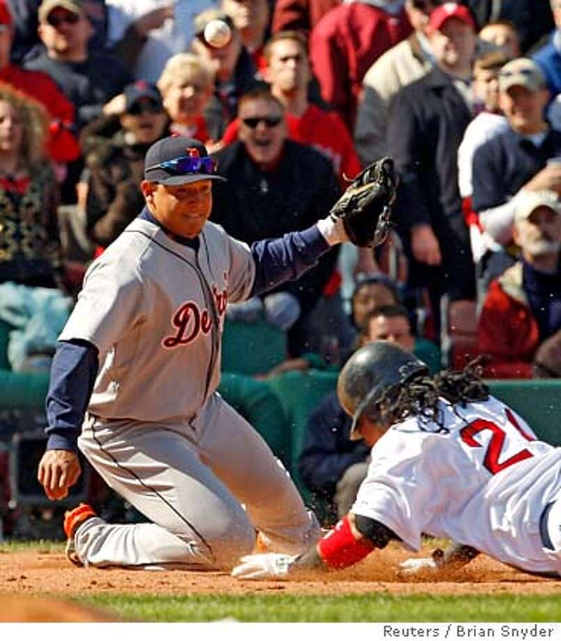 ###Live Caption:Boston Red Sox's Manny Ramirez (R) is safe at third base as Detroit Tigers third baseman Miguel Cabrera (L) fails to handle the relay throw in the third inning of their MLB baseball game in Boston, Massachusetts April 8, 2008. Ramirez was given home plate when the ball went out of play. REUTERS/Brian Snyder (UNITED STATES)###Caption History:Boston Red Sox's Manny Ramirez (R) is safe at third base as Detroit Tigers third baseman Miguel Cabrera (L) fails to handle the relay throw in the third inning of their MLB baseball game in Boston, Massachusetts April 8, 2008. Ramirez was given home plate when the ball went out of play. REUTERS/Brian Snyder (UNITED STATES)###Notes:Boston Red Sox's Ramirez is safe at third base as Detroit Tigers third baseman Cabrera fails to handle relay throw in Boston###Special Instructions:0 Photo: BRIAN SNYDER