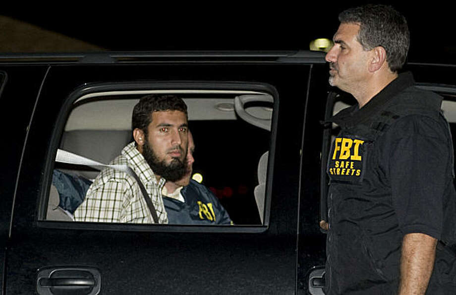 ** RE-TRANS WITH ALTERNATE CROP ** Terrorism suspect Najibullah Zazi is arrested by FBI agents in Aurora, Colo., late Saturday, Sept. 19, 2009.  (AP Photo/Chris Schneider - Denver Post)  - MANDATORY CREDIT - Photo: Chris Schneider, AP