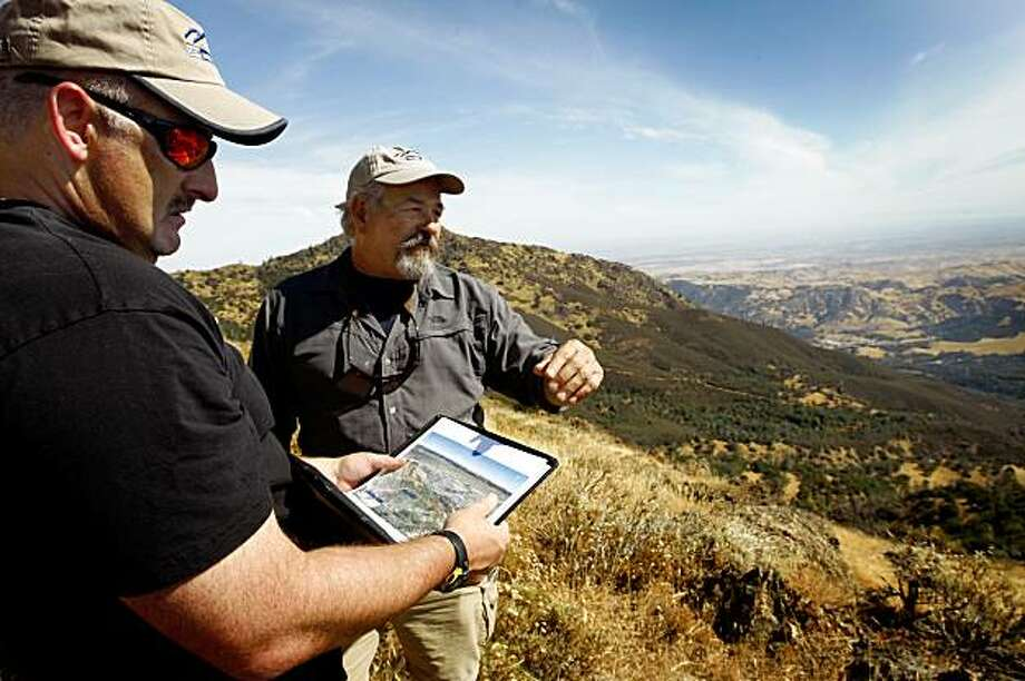 Save Mount Diablo's Seth Adams (left) and Ron Brown view the newly acquired Viera-North Peak parcel of land during a hike in Mount Diablo State Park, Calif., on Thursday, Sept. 10, 2009. Photo: Paul Chinn, The Chronicle