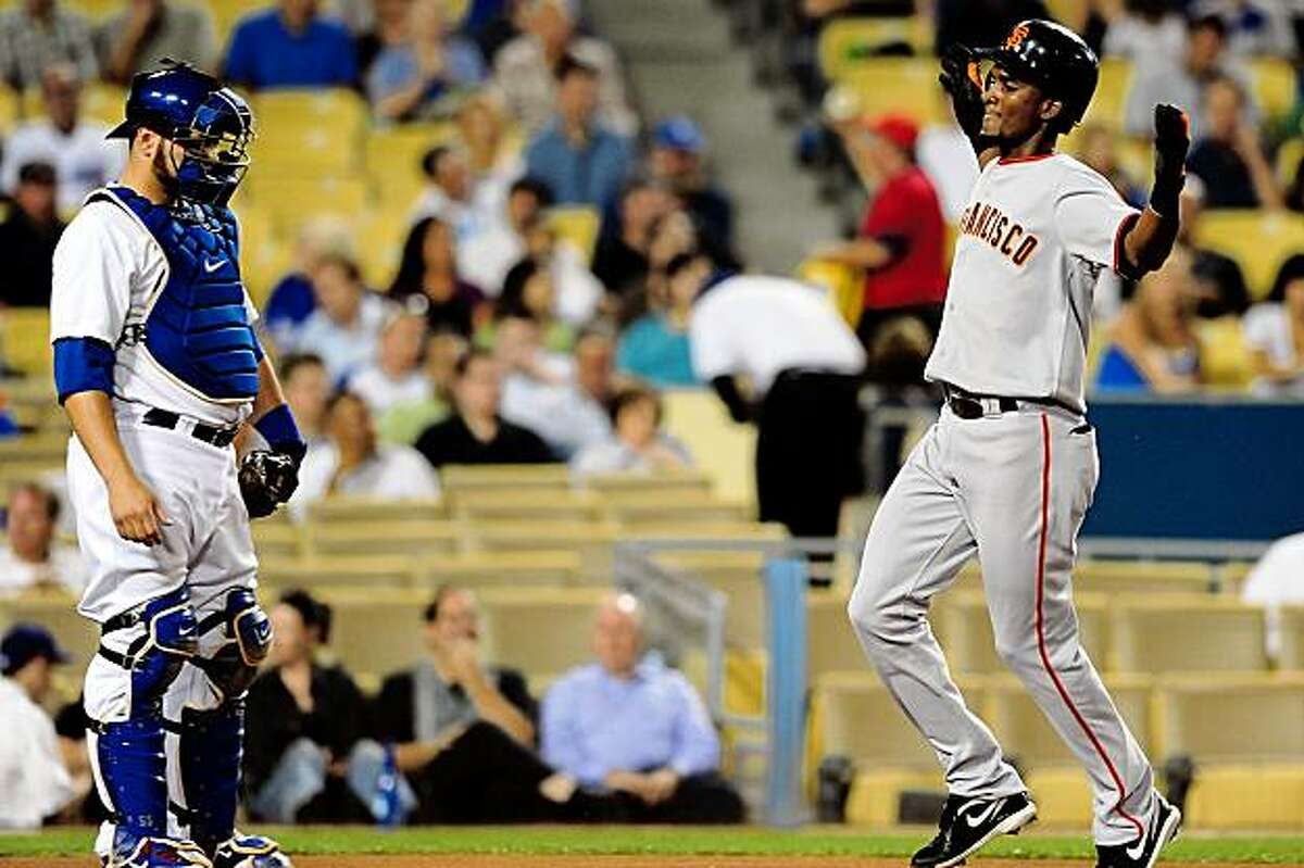 Eugenio Velez celebrates after hitting a home run in the first inning against the Los Angeles Dodgers on Friday.