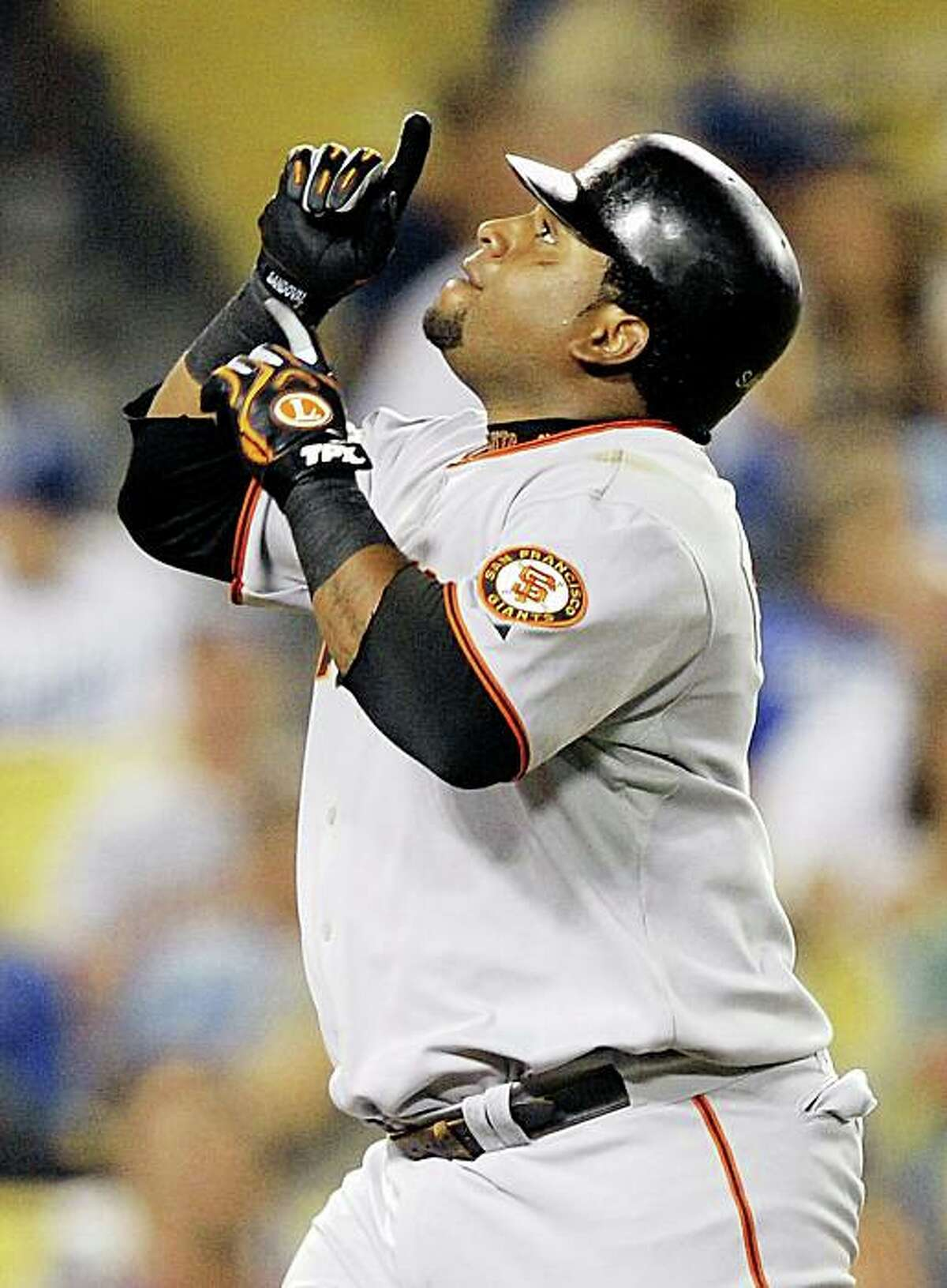 San Francisco Giants' Pablo Sandoval celebrates after hitting a three-run home run during the third inning of their Major League Baseball game against the Los Angeles Dodgers, Friday, Sept. 18, 2009, in Los Angeles. (AP Photo/Mark J. Terrill)