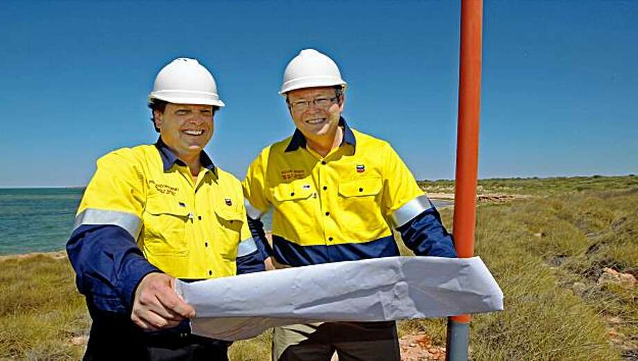 Australian Prime Minister Kevin Rudd (L) and Chevron Managing Director Roy Krzywosinski (R) inspect the site of the proposed Gorgan gas project at Town Point on Barrow Island, off the coast of Western Australia, on September 1, 2009.  Rudd announced on September 10 that energy giant Chevron Australia signed deals worth up to 60 billion USD to supply liquefied natural gas (LNG) to Japan and South Korea from 2014.    AFP PHOTO/WEST AUSTRALIAN/Mogens JOHANSEN (Photo credit should read MOGENS JOHANSEN/AFP/Getty Images) Photo: Mogens Johansen, AFP/Getty Images